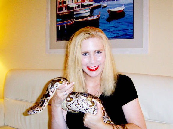 Taryn Hook with Larry, a beloved boa constrictor whose affliction prompted the lifelong keeper of reptiles to get in touch with a researcher who hunts down viruses. Credit: Larry Taormina, Ph.D